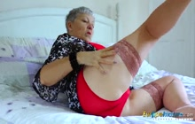 Europe Granny Savana masturbating on the bed