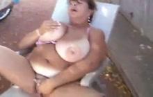Fat granny masturbates outside for us