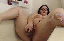 Obese girl masturbating in bathtub