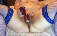 BBW in blue fishnet stockings toying her cunt