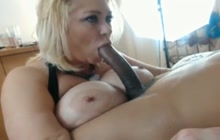 BBW with huge tits sucking a huge dick