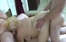 Fat matures sharing a cock